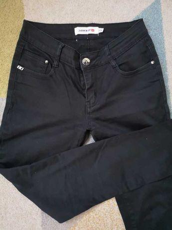 36 S rurki czarne spodnie jeansy