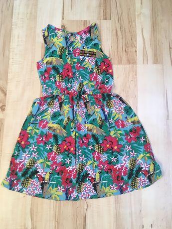Śliczna sukienka rozm.134