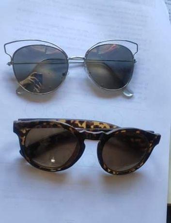 Conjunto dois óculos de sol como novos