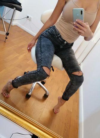 Spodnie dżinsy z obdarciami S/36