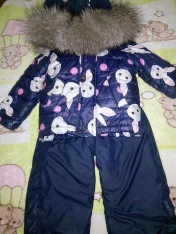 Зимний комбинезон для девочки с натуральным мехом.