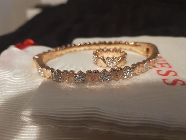 GUESS pierścionek i sztywna blansoletka kolor różowe złoto-roz. 6