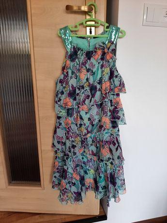 Sukienka dziewczęca w kwiaty 146/152
