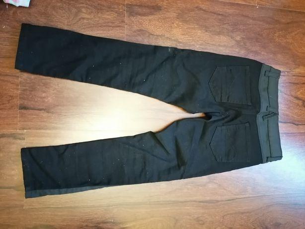 Czarne eleganckie spodnie na 7 lat jak nowe