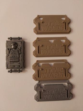 Lego star wars. Ludzik zatopiony w metalu lego, podstawki star wars