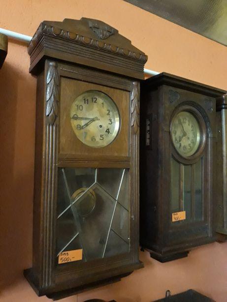 Stary zegar z wahadłem, w pełni sprawny, nakręcany kluczem