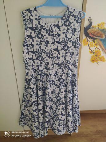 Elegancka sukienka na podszewce kloszowana 134