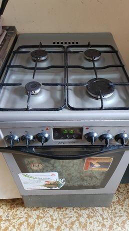 Kuchenka gazowa Mastercook z piekarnikiem elektrycznym.