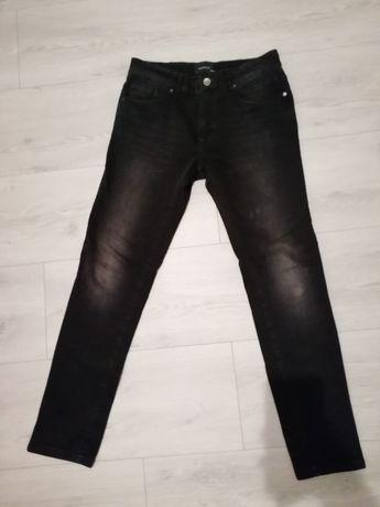 Spodnie na pasku Reserved czarne