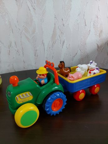 Продам игрушку ( музыкальный трактор)