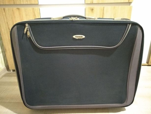 Большая дорожная сумка-чемодан на четырёх колесах