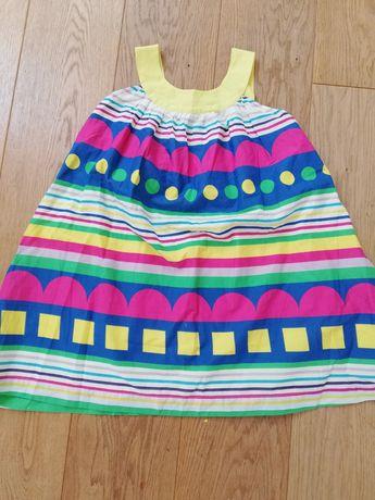 Piękna sukienka z Benettona r. M (130 cm)