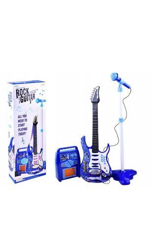 Gitara elektryczna, mikrofon, wzmacniacz.
