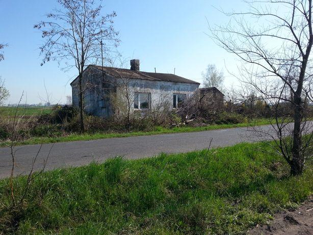 Dom z działką i zabudowaniami