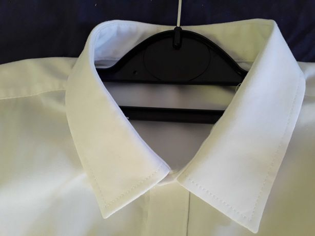 Koszula biała na 8-9  lat jak nowa.