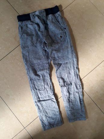 Spodnie NEXT r 134 cm materiałowe