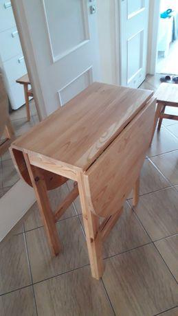 Stół do kuchni rozkładany drewniany  plus 3 drewniane taborety.
