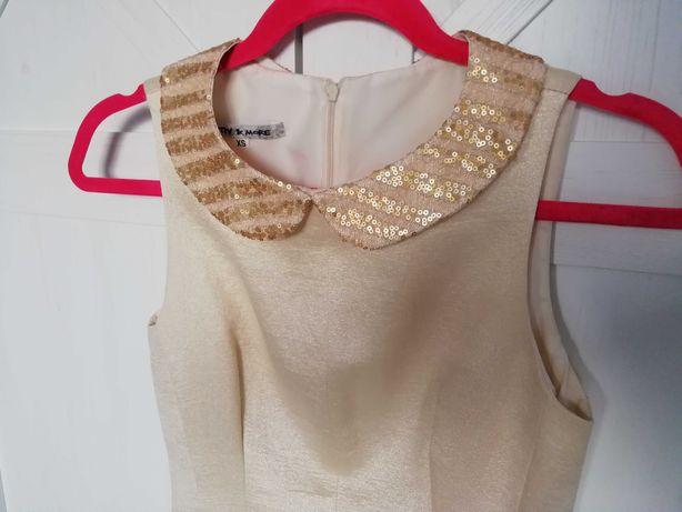 Złota elegancka sukienka z kołnierzykiem