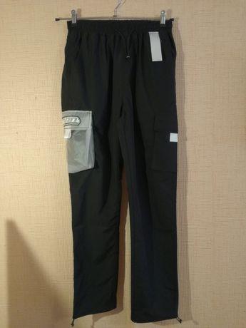 Spodnie treningowe Man International S wzrost około 165/ 170