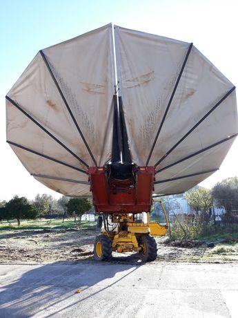 Empilhador telescópico com vibrador de azeitona