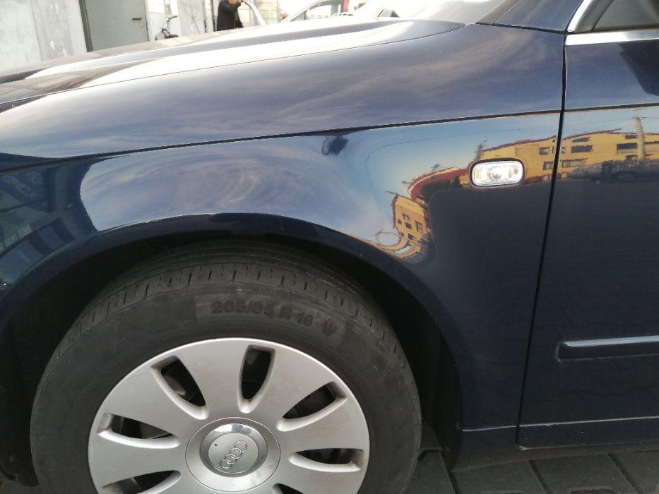 Błotnik przedni lewy Audi A4 B7 lakier LZ5J Świba - image 1