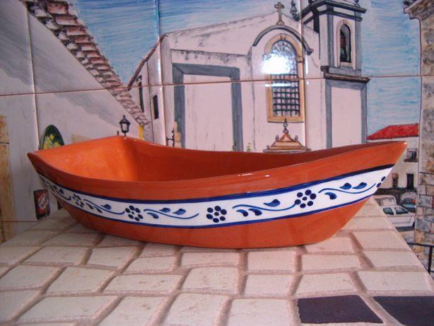 Barco em barro para marisco