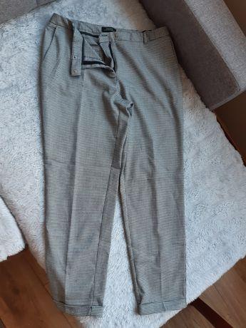 Spodnie w kratkę z kantem eleganckie