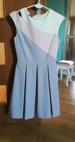 Jasna rozkloszowana sukienka rozmiar S/36 jak nowa Forti