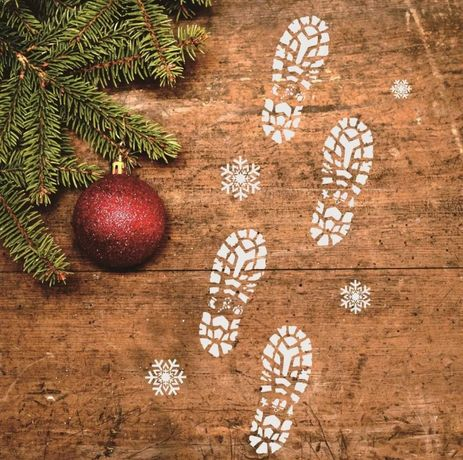 Ślady stopy Mikołaja Santa święta odciski buta butów Świętego Mikołaja
