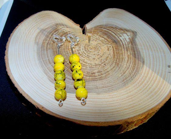 Żółte kulki z czarnym wzorem klipsy