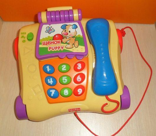 Обучающий телефон - каталка от Fisher-Price.Состояние новой игрушки