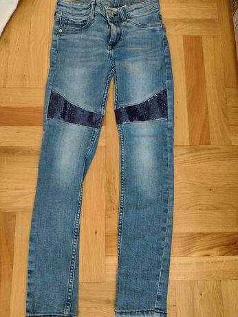 Spodnie jeansy rurki z cekinami rozmiar 134 stan idealny
