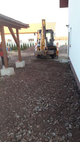 Utwardzanie terenu, podbudowę pow kostkę przyłącza wod-kanalizacyjne