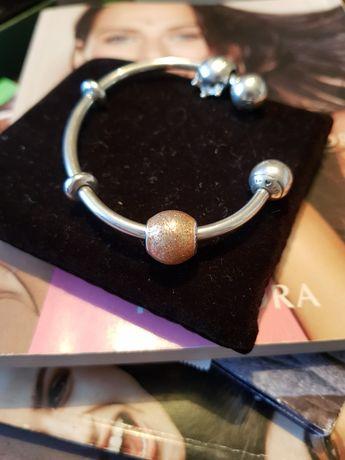 Sprzedam oryginalny charms Pandora Różowozłoty brokat