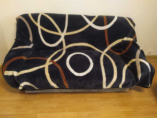 Sofa rozkładana 174x82x90cm w kolorze szarym po przejściach