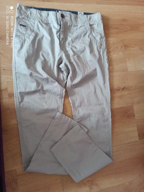Diverse 31 męskie spodnie beżowe długość 105