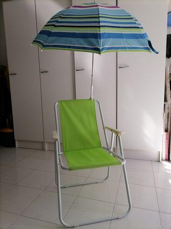Cadeira e chapéu de sol novos.