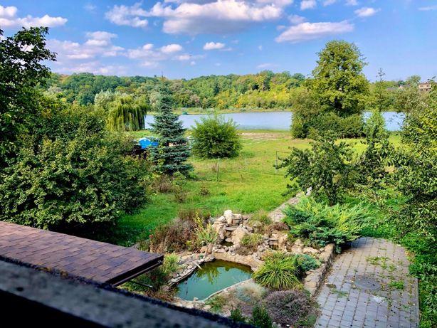 Дом с выходом к воде с. Красное Обуховский р-н. 250 м. 22 сотки
