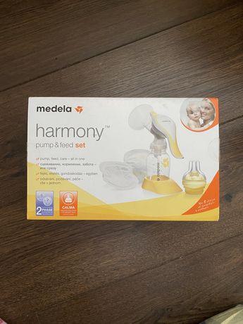 Молокоотсос medela harmony pump&feed