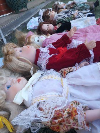 9 bonecas de porcelana e suporte