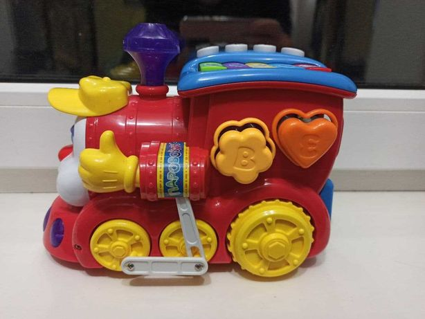 Музыкальная игрушка Hola Toys Паровозик-сортер