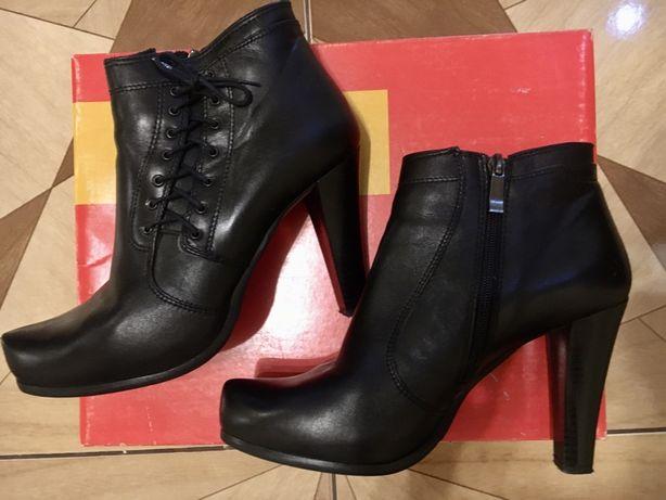 Продам кожаные ботинки на каблуке 39 размера