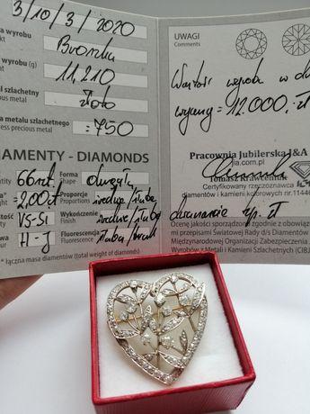 Złota broszka z diamentami.