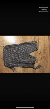 Spodnie w paski z wysokim stanem i paskiem