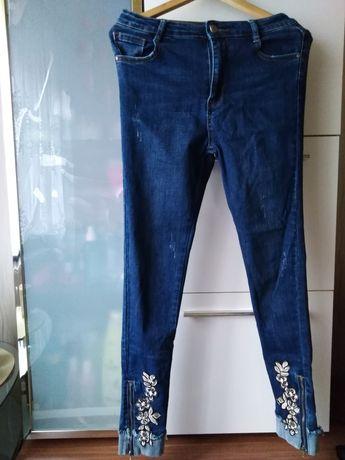 OKAZJA nowe spodnie modne z suwakami
