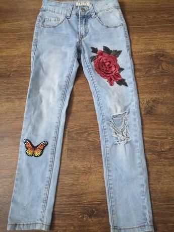 Spodnie, dżinsy dla dziewczynki rozmiar 122 /128