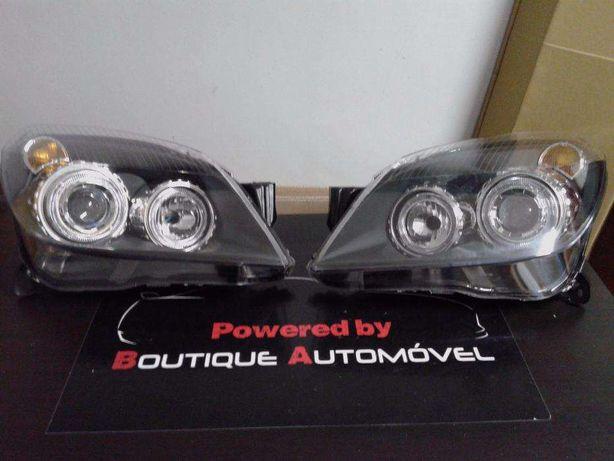 Faróis angel eyes fundo preto Opel Astra H