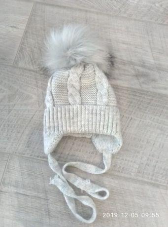 Продам вязанную шапку 150грн.