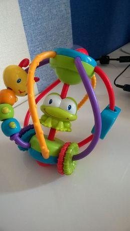 Развивающая игрушка погремушка Bright Starts Карусель от 6 месяцев