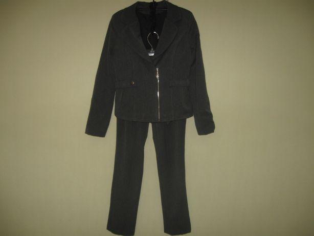 Школьный б/у брючный костюм для девочки.Рост 140см